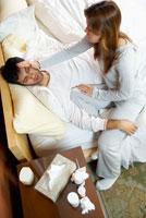 Woman Taking Care of Sick Man