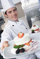 Chef Holding Desserts