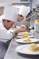 Chefs Garnishing Dishes