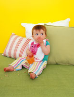 Baby on Pillows Eating Snack