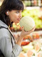 Woman Smelling Cantaloupe