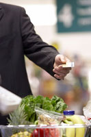 Man Paying For Groceries