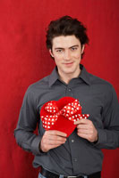 Man Holding Heart-Shaped Box