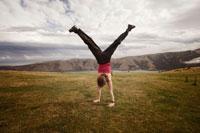 Woman Performing Cartwheel