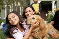Family in Front Yard with Dog