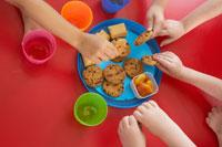 Childrens Hands Taking Cookies