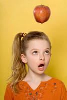 Girl Looking at Apple