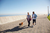 Couple Jogging with Dog