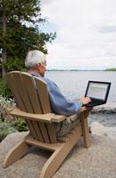 Man at the Cottage, UsingLaptop Computer