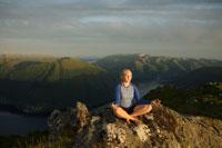 Woman Doing Yoga on MountainSummit