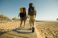 Backpackers on Beach Boardwalk