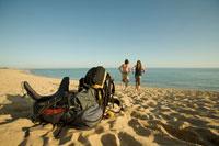 Backpackers Running to Ocean