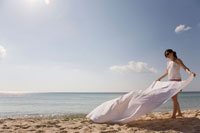 Woman with Blanket on Beach