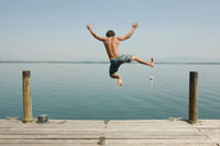 Man Jumping from Dock