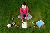 Businesswoman Sitting on Grass