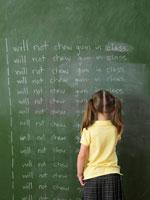 Girl Writing Lines on Chalkboard