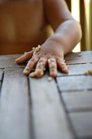 Child's Hand Covered with Food