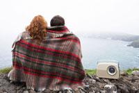 Couple Sitting on Stone Wall