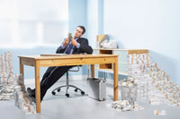 Businessman Surrounded by Money
