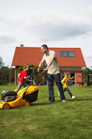 Dad Mowing the Lawn WhileKids Play
