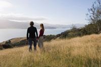 Couple Overlooking Akaroa Harbour