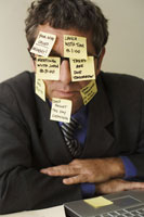 Businessman with Post-it NotesStuck to Face