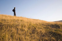 Man Hiking along Hillside