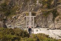 Man Crossing Bridge over River