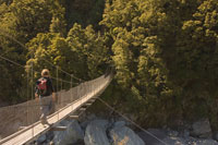 Man Crossing Footbridge