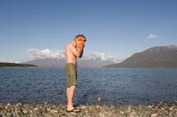 Man Drying Face by Lake