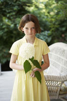 Girl on Porch with Flower