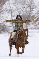 Cowgirl Riding Horse in Winter