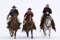 Cowboys Riding Horses in Winter