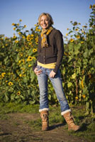 Woman Standing by Field ofSunflowers
