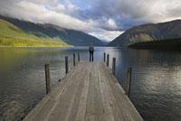 Man on Dock on Lake Rotoiti,Nelson Lakes National Park