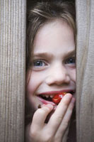 Portrait of Girl Eating Cherry