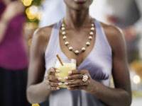 Close-up of Woman Holding Drinkat Christmas Party