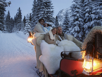 Couples riding in sleigh