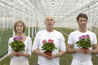 People holding flowers in greenhouse