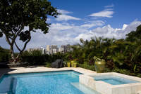 Outdoor swimming pool with view of downtown hawaiian city