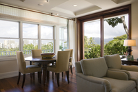 Sitting and dining area in home with downtown Hawaii city view