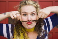 Woman Making Moustache with Hair