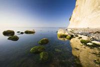 Rocks in Baltic Sea by Chalk Cliffs