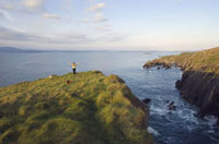 Woman Standing on Cliff by the Celtic Sea