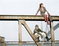 Man and woman sitting on steel girder