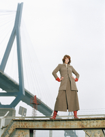Woman standing on steel girder