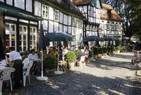 Germany, Bad Essen, Tourists in a sidewalk restaurant