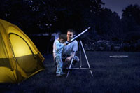 Father and Son Camping in the Backyard at Night