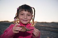 Girl Holding Horseshoe Crab