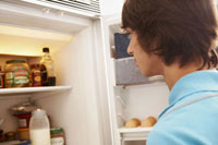 Teenage Boy Looking in the Refrigerator